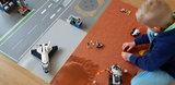 LEGO 60225 60226 op een speelmat